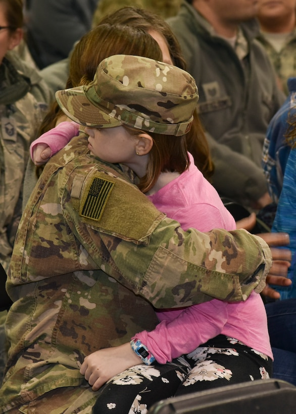 Master Sgt. Nichole Gruber, 114th Civil Engineer Squadron first sergeant, hugs her daughter during a welcome home ceremony March 4, 2018 at Joe Foss Field.