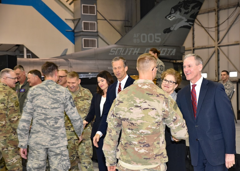 South Dakota Governor Dennis Daugaard and distinguished guests shake hands with 114th Fighter Wing Airmen during a welcome home ceremony March 4, 2018 at Joe Foss Field.