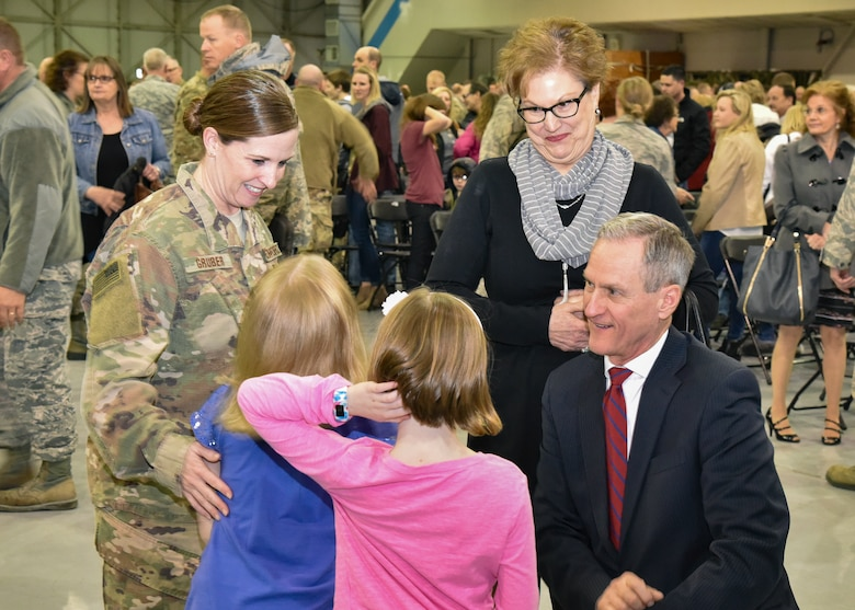 Master Sgt. Nichole Gruber, 114th Civil Engineer Squadron first sergeant, and her family visits with South Dakota Governor Dennis Daugaard and First Lady Linda during a welcome home ceremony March 4, 2018 at Joe Foss Field.