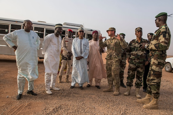 U.S. Air Force Lt. Col. Brad Harbaugh, 724th Expeditionary Air Base Squadron commander, gives commanders of the Forces Armées Nigeriennes and Agadez civic leaders a tour of base construction projects Feb. 21, 2018, at Nigerien Air Base 201, Niger. Harbaugh used the tour to discuss with civic leaders how integrated capabilities and interoperability promote regional partnerships. (U.S. Air Force photo by Tech. Sgt. Nick Wilson)