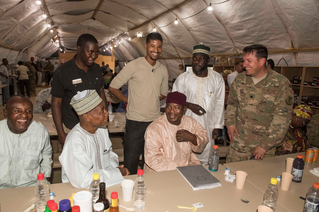 U.S. Air Force Lt. Col. Brad Harbaugh, 724th Expeditionary Air Base Squadron commander, laughs with members of the Forces Armées Nigeriennes and Agadez civic leaders during a social gathering at Nigerien Air Base 201's dining facility, Feb. 21, 2018. The U.S. military is in Agadez at the request of the Government of Niger, and remains committed to helping its African partners protect their borders with matters of national security, and with other efforts important to the citizens of Niger. (U.S. Air Force photo by Tech. Sgt. Nick Wilson)