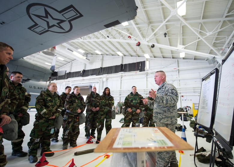 U.S. Air Force Senior Master Sgt. Jon Pieters, right, with the 133rd Civil Engineer Squadron, teaches a class on post attack reconnaissance sweeps in St. Paul, Minn., Feb. 24, 2018.