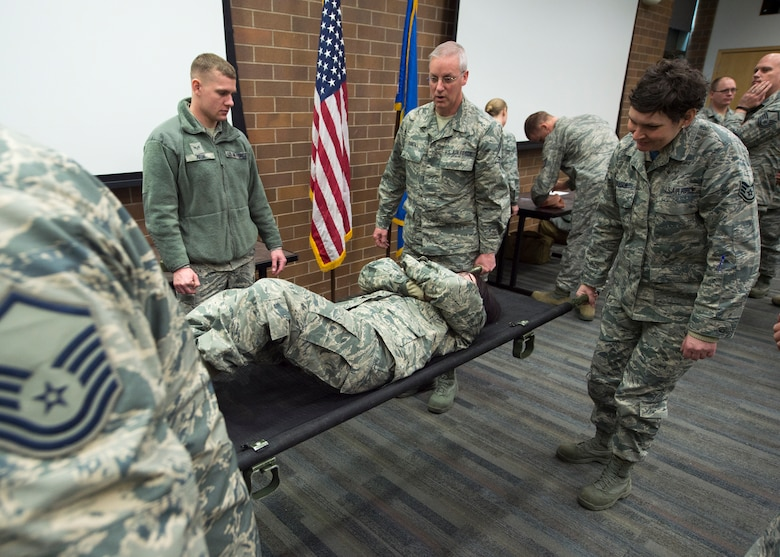 U.S. Air Force Airmen with the 133rd Airlift Wing partake in a self-aid buddy care class St. Paul, Minn., Feb. 24, 2018.