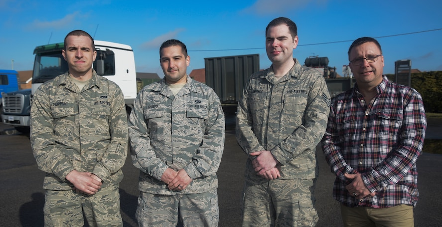 Three U.S. Air Force Airmen and a civilian assigned to the 100th Logistics Readiness Squadron pose for a photograph at RAF Mildenhall, England, March 5, 2018. The team of four were tasked to drive more than 500 miles through a snow storm to collect 30 tons of anti-icing product for the airfield. Their efforts, along with a team of Airmen involved in logistics planning, allowed the RAF Mildenhall airfield to remain operational during the storm.  (U.S. Air Force photo by Senior Airman Justine Rho)