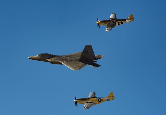 Photo of a F-22 Raptor in formation with two P-51 Mustangs at Heritage Flight Training