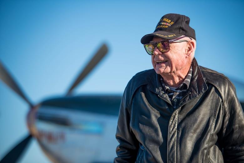 Deane Mitchell, a World War II veteran, pilot, tours a vintage P-51 Mustang
