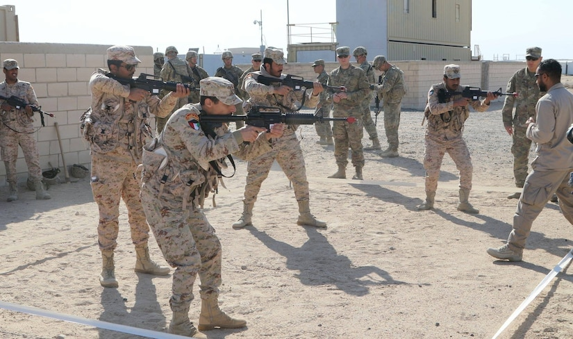 Iron Soldiers embrace international interoperability as they partnered and conduct training with the Kuwaiti Land Forces. Soldiers with the 1st Battalion, 35th Armored Regiment, showed an array of skills from clearing rooms and urban defense to squad attack in order to minimize the effects of the enemy's defensive fires during movement.