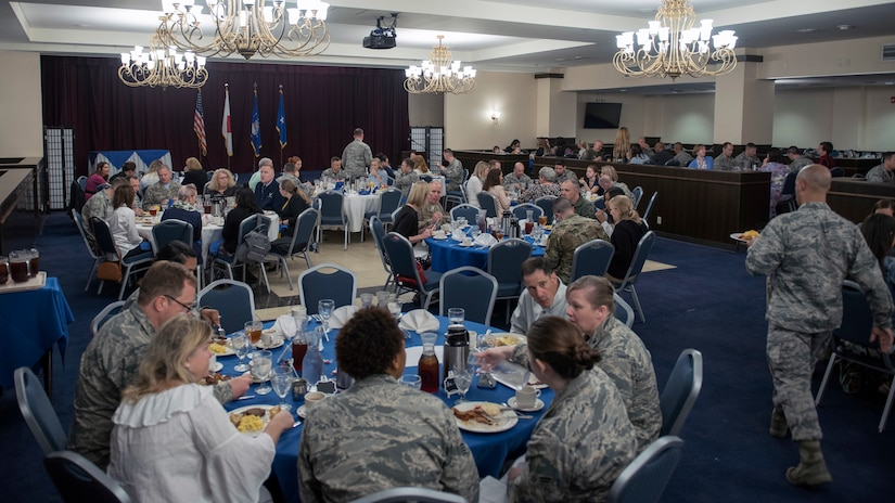 Attendees listen to an announcement during a Key Spouse appreciation luncheon at Kadena Air Base, Japan, March 2, 2018. Key Spouses are commander-appointed and serve as a resource as part of efforts to support Air Force families. Air Force photo by Airman 1st Class Greg Erwin