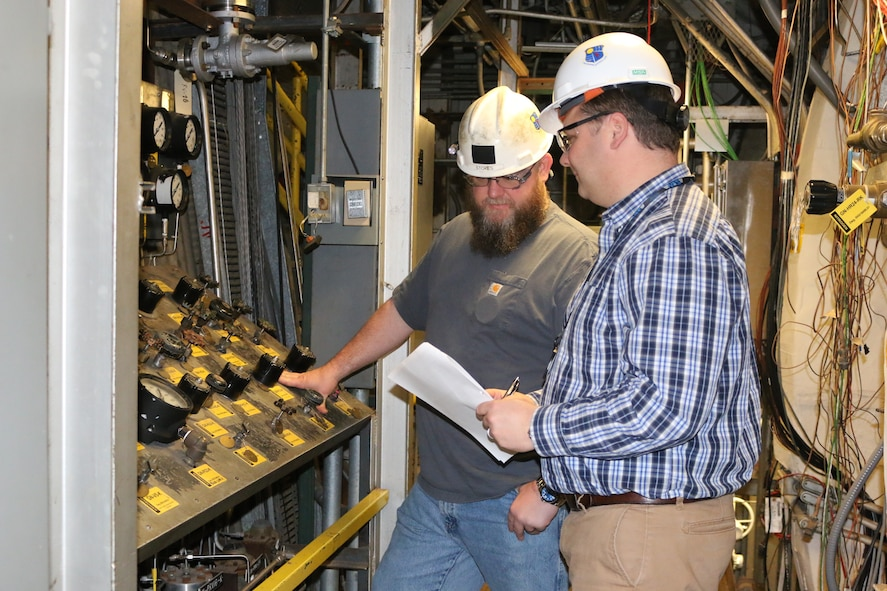 Ryan Allen, at right, a lead test operations engineer, and Troy Stokes, lead outside machinist, set up a GN2 panel for system checkouts prior to a test in one of the jet engine test facilities at Arnold Air Force Base. In his position as operations engineer, Allen leads and coordinates activities of the test cell, plant and test article during a test. (U.S. Air Force photos/Deidre Ortiz)