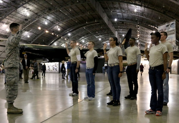 Capt. Jarrod Begy, 71st Intelligence Squadron, administers the Oath of Enlistment to the 445th Airlift Wing recruits Feb. 24, 2018 at the National Museum of the U.S. Air Force.