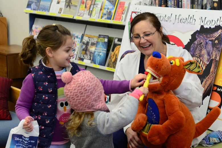 Mercy Padgett, 341st Medical Operations Squadron chief of preventative dentistry, uses a mascot, Roo, to teach children how to properly brush their teeth Feb. 20, 2018, at Malmstrom Air Force Base, Mont.