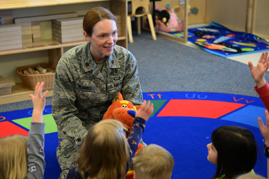Maj. Amber Russell, 341st Medical Group general dentist, visits the child development center to inform children about dental health Feb. 21, 2018, at Malmstrom Air Force Base, Mont.