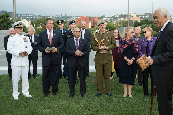 Admiral Harry Harris, along with Ambassador Scott Brown, New Zealand Minister of Defence, Hon. Ron Mark and Chief of the New Zealand Defence Force, Lt. Gen. Tim Keating each hold Mauri stones while Peter Jackson blesses the site of the United States Memorial, which will be installed at Pukeahu National War Memorial Park this year.