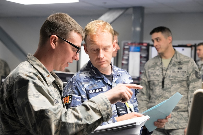 Cyber Mission Defense Team personnel from Scott review documents during Red Flag 18-1.