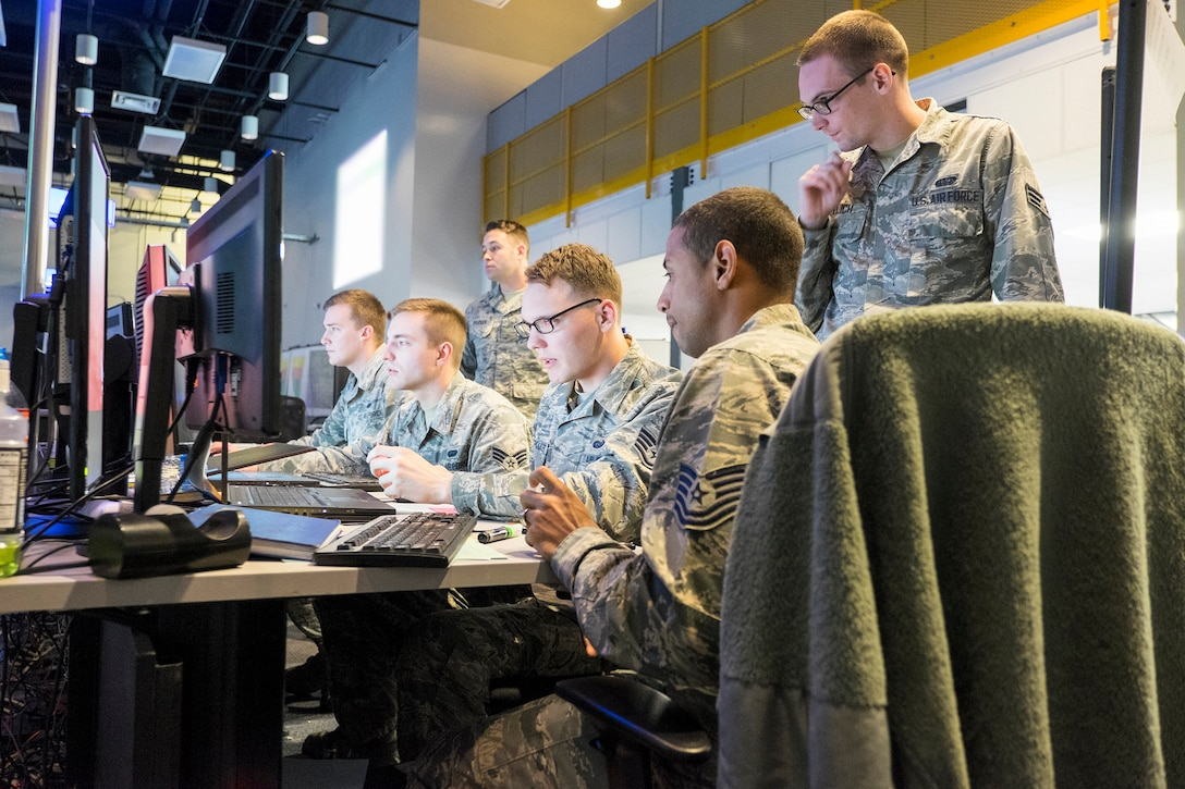 Members of a Cyber Mission Defense Team from Scott participate in the annual Red Flag exercise at Nellis Air Force Base, Nevada. The exercise helps build the skills necessary to defend an Air Operations Center.