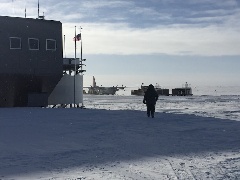 Master Sgt. Charles Workman, a 130th Airlift Wing Electro/Environmental Systems Specialist, walks toward an LC-130 in Antarctica during a 5-week temporary duty assignment. Workman provided electrical maintenance support to the LC-130 as a part of Operation Deep Freeze, an inter-agency, multi-national research and investigative mission run by the National Science Foundation. (Courtesy Photo)