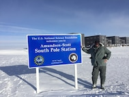Master Sgt. Charles Workman, a 130th Airlift Wing Electro/Environmental Systems Specialist, poses next to a sign signifying the South Pole Station in Antarctica during a 5-week temporary duty assignment. Workman provided electrical maintenance support to the LC-130 as a part of Operation Deep Freeze, an inter-agency, multi-national research and investigative mission run by the National Science Foundation. (Courtesy Photo)