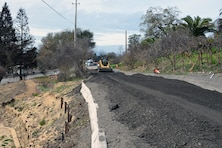 In order to make this road usable, contractors brought in fill dirt and rock, graded and widened the stretch of the road, and turned an unsafe road into one that could support trucks and other heavy equipment. (U.S. Army photo by J. Paul Bruton/Released)