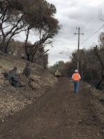 Sacramento District's Mark Swenson looks over a newly graded road created to give contractors access to 21 previously inaccessible properties. (U.S. Army photo by J. Paul Bruton/Released)