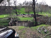 This property in Sonoma County had a small bridge that burned during the wildfire. The Corps of Engineers was able to find an alternate route to reach the parcel and have the debris removed. (U.S. Army photo by J. Paul Bruton/Released)