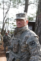 Observer Controller/Training NCO stands ready to teach Warrior Task Training