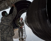 Team JSTARS Airmen install engine cowling on an E-8C Joint STARS