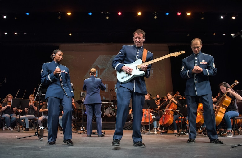 "Musicians from the rock music group ""Mobility"" of The United States Air Force Band of the Golden West, Travis Air Force Base, Calif., perform with the Napa Valley Youth Symphony at the Veteran's Home in Yountville, Calif., March 4, 2018. The band and symphony are performing together after the original concert, scheduled in October 2017, was canceled due to devastating wildfires in Napa and Sonoma counties. (U.S. Air Force photo by Louis Briscese)"