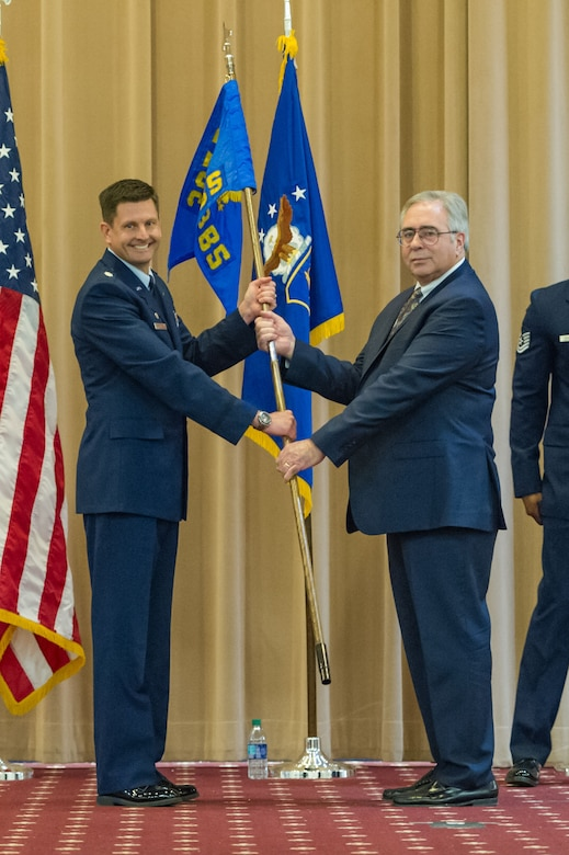 George Carroll III, president of Experimental Aircraft Association Chapter 343, shares the 343rd Bomb Squadron guidon from Lt. Col. John Booker, commander of the 343rd BS, during an honorary commander's induction ceremony at Barksdale Air Force Base, Louisiana, March 3, 2018.