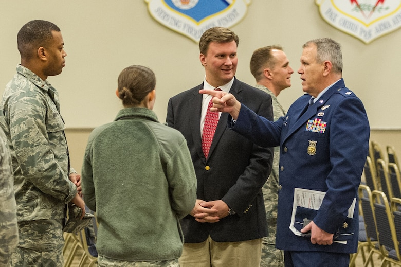 David R. Rockett, Jr., president of the Greater Bossier Economic Development Foundation, and Lt. Col. Alan Spiller, commander of the 307th Civil Engineer Squadron, talk with Airmen of the 307th CES before an honorary commander's induction ceremony at Barksdale Air Force Base, Louisiana, March 3, 2018.