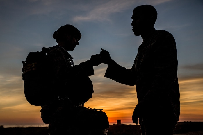 U.S. Marines with 1st Reconnaissance Battalion, 1st Marine Division, fist bump each other prior to a low level static line (LLSL) parachute operations at Marine Corps Base Camp Pendleton, Calif., Feb. 1, 2018