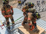 Firefighters from the 96th Civil Engineer Group rappelled from the top of their new structural training facility to cut the ribbon marking its official opening here March 1.