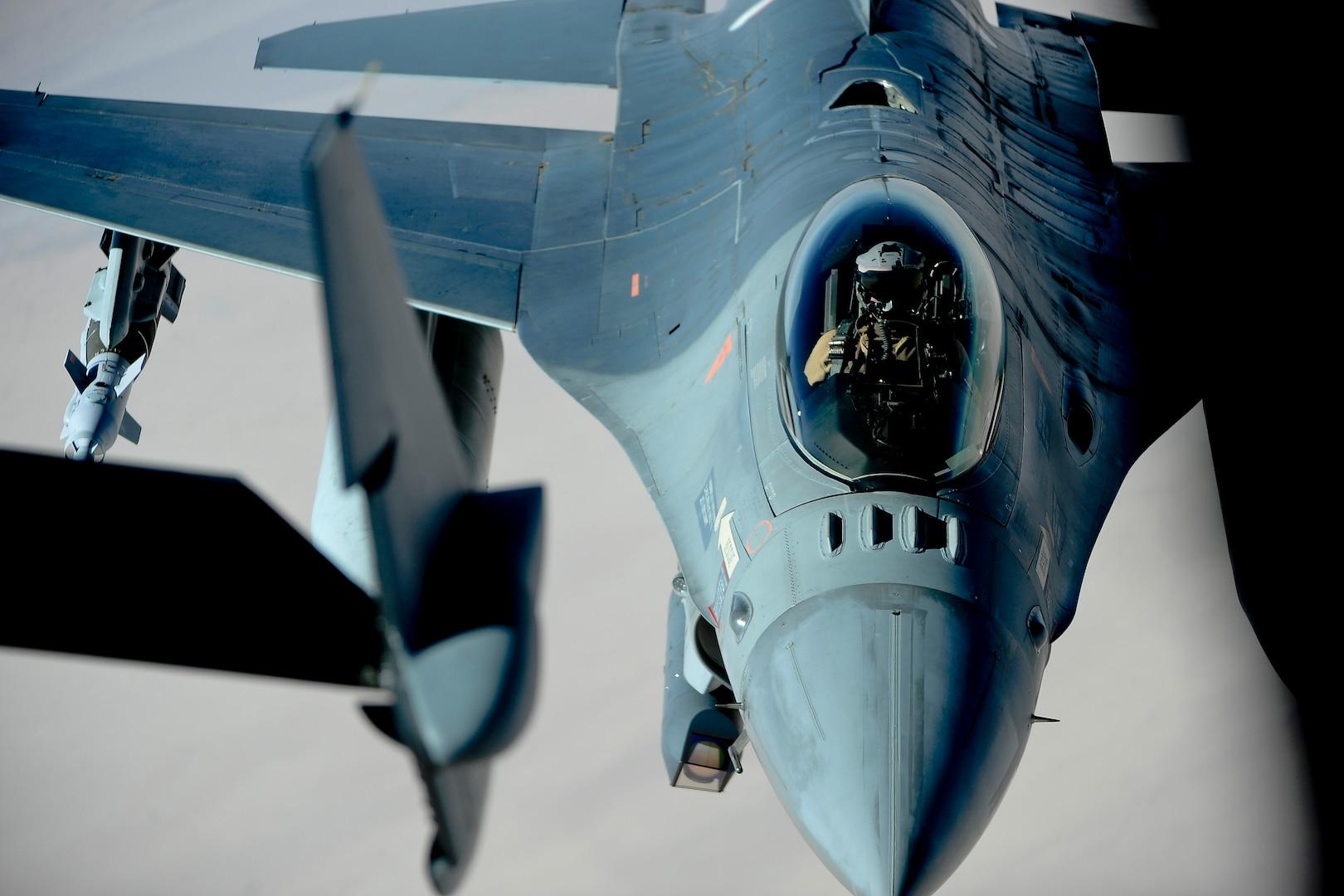 An aircraft refuels another midair.