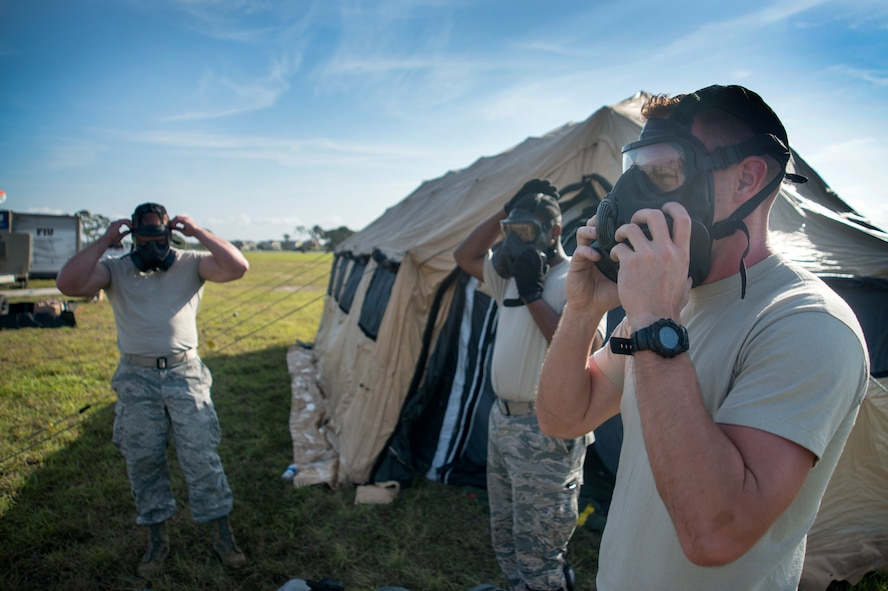 U.S. Air Force Airmen assigned to the 46th Aerial Port Squadron (APS) at Dover Air Force Base, Del., test out their equipment at MacDill Air Force Base, Fla., Feb. 28, 2018