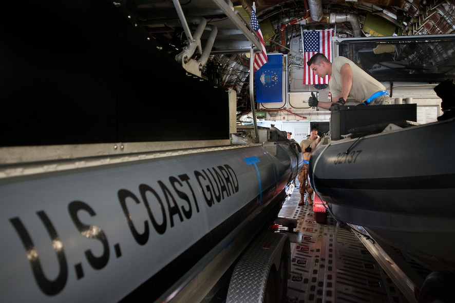 U.S. Air Force Airmen assigned to the 46th Aerial Port Squadron (APS) at Dover Air Force Base, Del., marshal in a U.S. Coast Guard transportable port security boat (TPSB) at MacDill Air Force Base, Fla., Feb. 28, 2018.