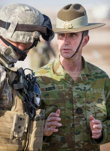 Australian soldiers speaking to each other.