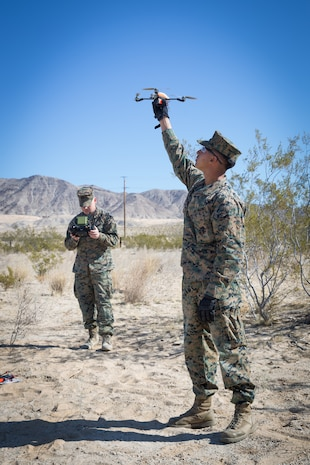 U.S. Marines Lance Cpl. Jonathan Herreracorral, a chemical, biological, radiological and nuclear defense specialist, and David Bobbie, an intelligence specialist, both with 3rd Battalion, 7th Marine Regiment, 1st Marine Division, conduct start-up drills for the InstantEye Quadcopter during a Quad for Squads training event on Marine Corps Air Ground Combat Center, Twentynine Palms, Calif., Feb. 28, 2018.