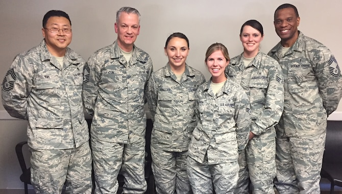 Staff Sgt Alyson Venegas, Senior Airmen Linda Wilson, and Senior Airman Logan Bennett, 99th Medical Group Aerospace Medical Technicians, stand with CMSgt Steven Cum, Chief, Medical Enlisted Force (CMEF) and Enlisted Corps Chief, Office of the Surgeon General. U.S. Air Force, CMSgt Tracy Washington, and CMSgt John Yun at Nellis Air Force Base, Las Vegas, Nev., March 1, 2018. Venegas, Wilson, and Bennett attended the Route 91 Harvest Festival in Las Vegas, Nev., Oct. 1, 2017, when a gunman opened fire on concert-goers, causing the deadliest mass casualty incident in modern American history. While under continuous fire, Venegas, Wilson, and Bennett provided lifesaving trauma interventions to victims of the mass casualty shooting. (U.S. Air Force photo)