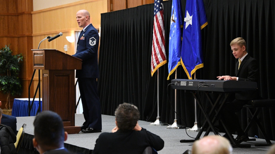 Master Sgt. Jared Graham and his son Tyson perform during the National Prayer Brerakfast at Hill Air Force Base, Utah, March 2, 2018. (U.S. Air Force photo by R. Nial Bradshaw)