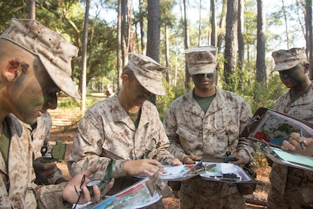 U.S. Marine Corps recruits with Oscar Co., 4th Battalion, Recruit Training Regiment (RTR) and India Co., 3rd Battalion, RTR, record their destination points during a land navigation course at Elliot's Beach on Marine Corps Recruit Depot, Parris Island, S.C., Nov. 6, 2017.