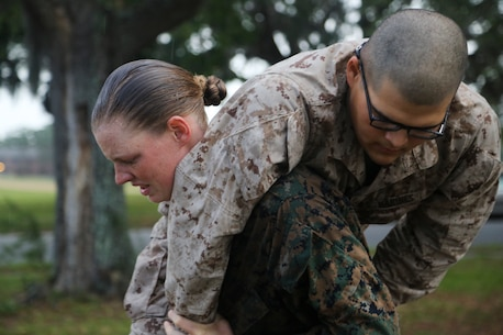 U.S. Marine Corps Rct. Brooke Gearheart with Platoon 4020, Company O, 4th Battalion carries Rct. Chase Thomas with Platoon 2040, Company G, 2nd Battalion during the maneuver under fire portion of the Combat Fitness Test during an initial CFT on Marine Corps Recruit Depot, Parris Island, S.C., May, 13, 2017.