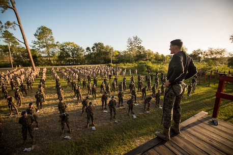 U.S. Marine Corps Staff Sgt. Christopher D. Hobb, a field training instructor with Weapons and Field Training Battalion, demonstrates how to properly tie and tighten a rope harness Oct 4, 2017, to recruits of Hotel Company, 2nd Recruit Training Battalion, and Oscar Company, 4th Recruit Training Battalion, on Parris Island, S.C.