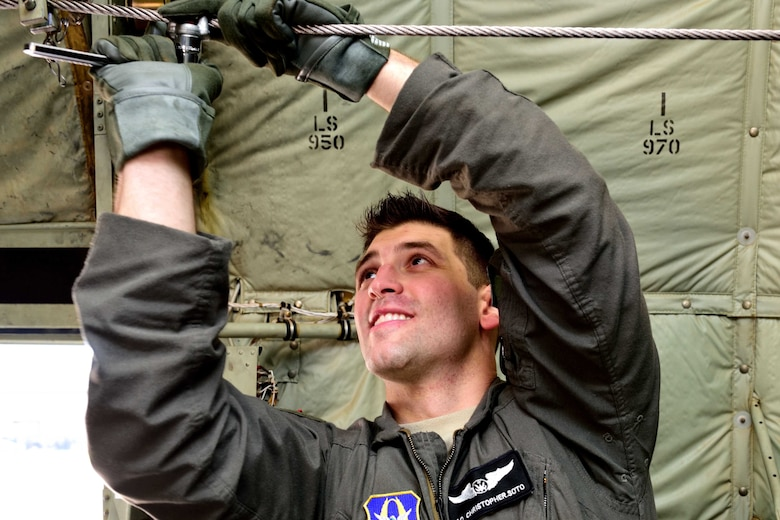 "Senior Airman Chris Soto, 815th Airlift Squadron loadmaster, installs an anchor cable stop for the towed parachutist retrieval system on a C-130J Super Hercules aircraft March 2 at Keesler Air Force Base, Mississippi, before taking off in support of Emerald Warrior 2018. The 815th AS ""Flying Jennies"" provided airlift support for the special operations joint training event at Hurlburt Field, Florida, Feb. 26-March 2. The exercise involved units from all U.S. military branches, U.S. Special Operations Command and North Atlantic Treaty Organization partner forces.  (U.S. Air Force photo by Tech. Sgt. Ryan Labadens)"