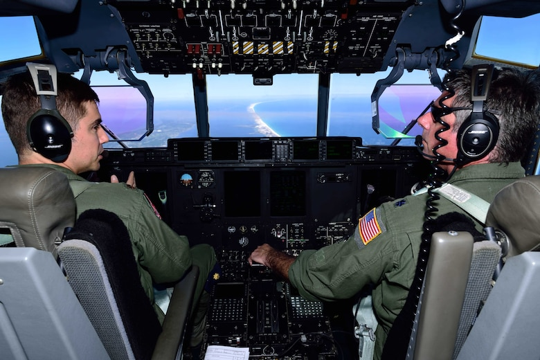 "Lt. Col. Scot Salminen (right) and Maj. Kevin Olsen, 815th Airlift Squadron pilots, discuss the flight path of their C-130J Super Hercules aircraft March 2 during Emerald Warrior 2018. The 815th AS ""Flying Jennies"" provided airlift support for the special operations joint training event at Hurlburt Field, Florida, Feb. 26-March 2. The exercise involved units from all U.S. military branches, U.S. Special Operations Command and North Atlantic Treaty Organization partner forces. (U.S. Air Force photo by Tech. Sgt. Ryan Labadens)"