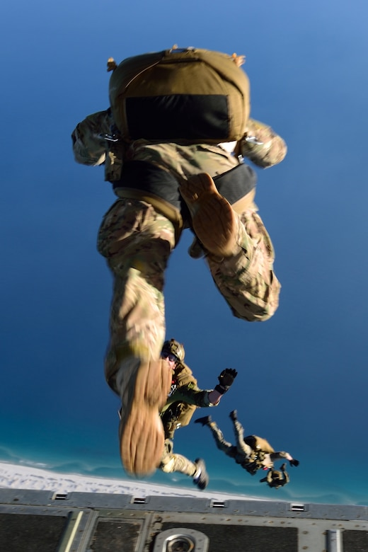 "Special Forces members jump out the back of a C-130J Super Hercules aircraft March 2 during Emerald Warrior 2018. The 815th AS ""Flying Jennies"" from Keesler Air Force Base, Mississippi, provided airlift support for Emerald Warrior 2018, a special operations joint training event involving various units from all U.S. military branches, the U.S. Special Operations Command and North Atlantic Treaty Organization partner forces from Feb. 26 to March 9. (U.S. Air Force photo by Tech. Sgt. Ryan Labadens)"
