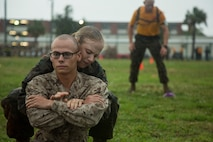 U.S. Marine Corps Recruits with Company O, 4th Battalion and Company G, 2nd Battalion move through the maneuver under fire portion of the Combat Fitness Test during an initial CFT on Marine Corps Recruit Depot, Parris Island, S.C.