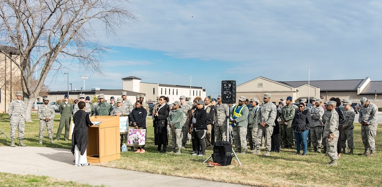 Ikira Peace, guest speaker for the Black History Month Unity Walk, speaks to attendees Feb. 28, 2018, on Dover Air Force Base, Del. The three-quarter mile Unity Walk was hosted by the African-American Heritage Committee in celebration of Black History month here at Dover AFB. (U.S. Air Force photo by Roland Balik)