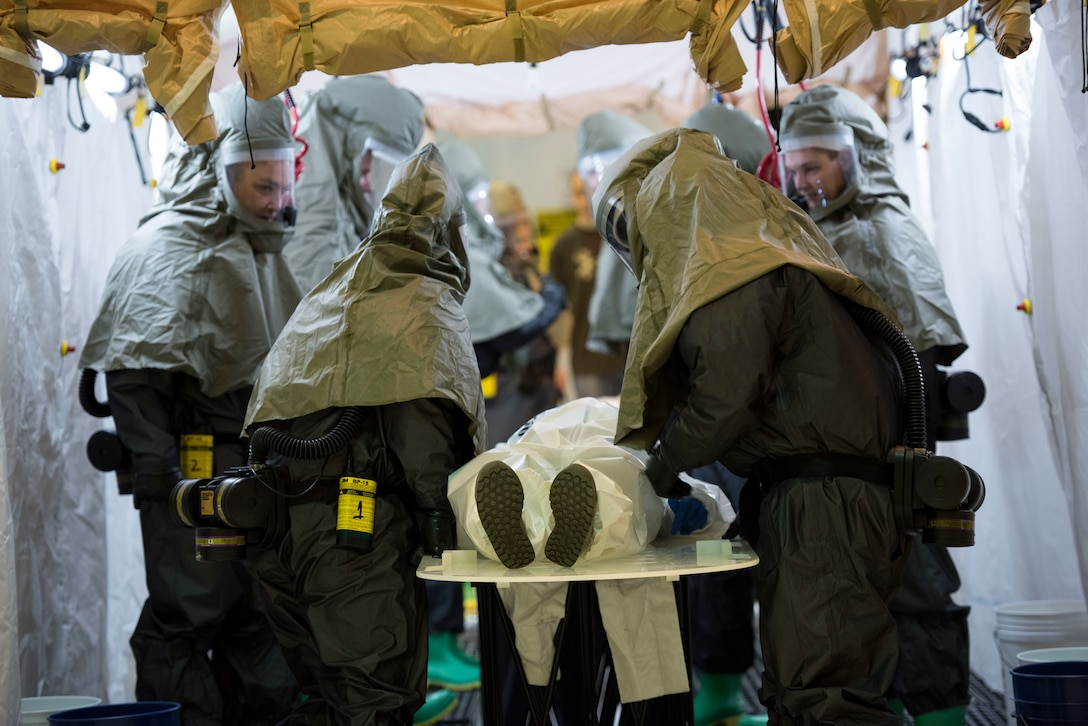 The 167th Airlift Wing's patient decontamination team works together to decontaminate a patient during a CAMR, or Counter CBRN (Chemical, Biological, Radiological and Nuclear) All-hazard Management Response Exercise, March 2, 2018.