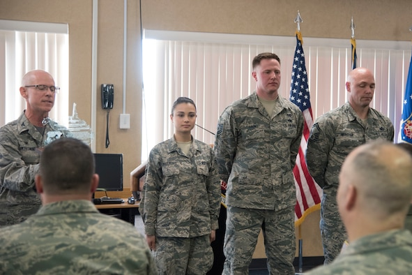Col. Shaun J. Perkowski (left), wing commander of the 167th Airlift Wing, presents the 167th AW's Outstanding Airmen of the Yea