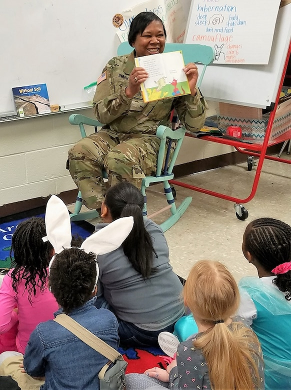 80th Training Command Soldier Staff Sgt. Catherine Smith reads to children at Hopkins Elementary School in Chesterfield, Virginia, on March 2, 2018, in celebration of Dr. Seuss' birthday, which is part of the National Read Across America Day.