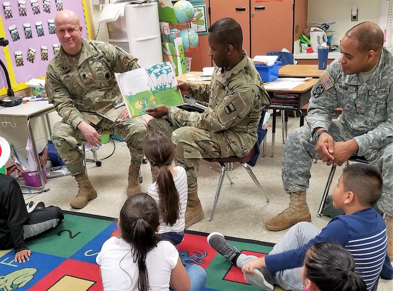 Brig. Gen. Fletcher Washington, deputy commanding general of the 80th Training Command, reads to children at Hopkins Elementary School in Chesterfield, Virginia, on March 2, 2018, in celebration of Dr. Seuss' birthday, as part of the National Read Across America Day.
